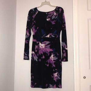 BEAUTIFUL black fitted JLO dress .